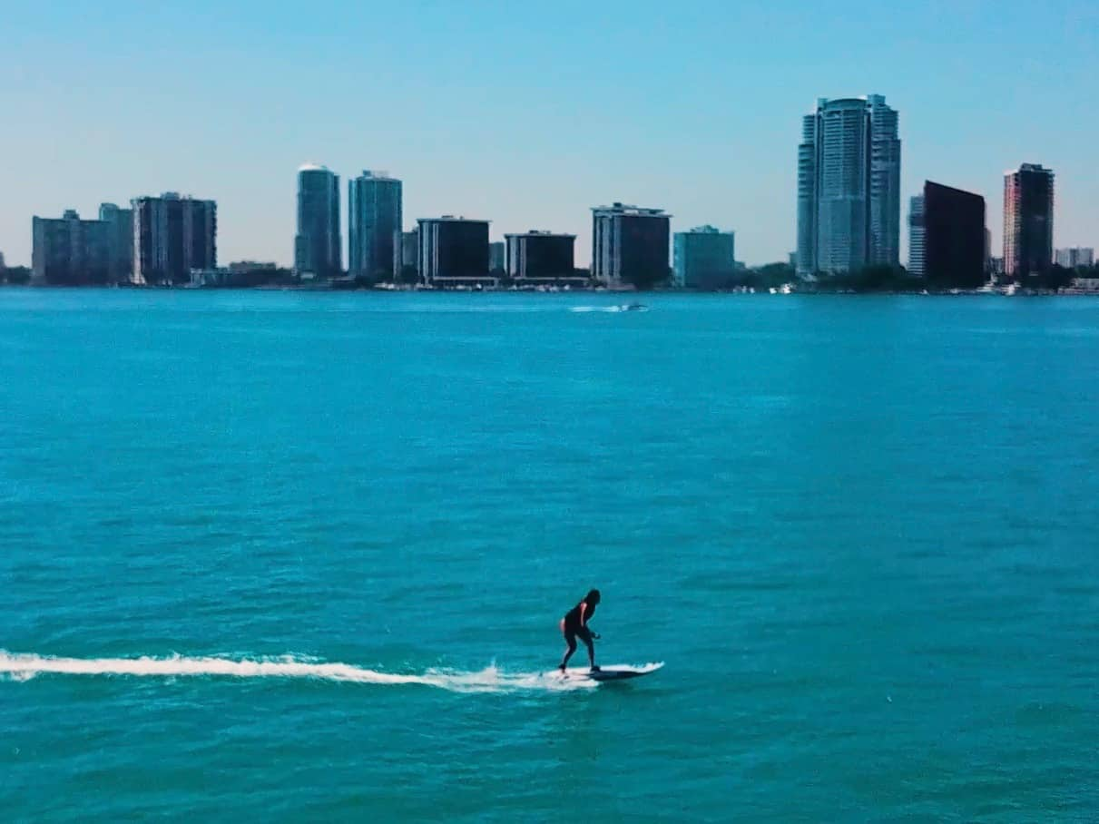 Blue water and skycrapers Onean Carver Electric Jetboard